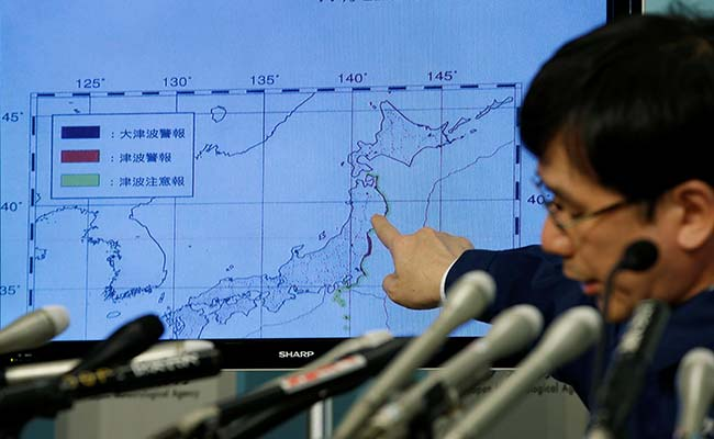 Tsunami hits Japan after strong quake near Fukushima disaster site