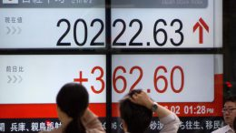Tokyo stocks close flat after central bank meet