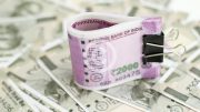Rupee slips further by 11 paise to 64.04 against dollar