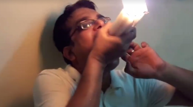 Mumbai man holds 22 LIT CANDLES in mouth; creates Guinness World Record